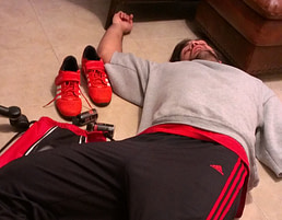 Passed out on the floor after a grueling 2nd attempt to conquer 210lbs.